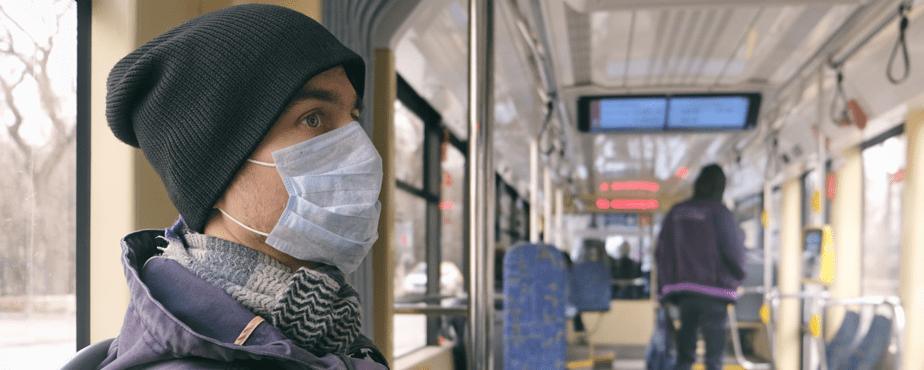 man-in-mask-on-transit APA 2020